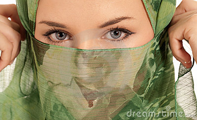 Young arab woman with veil showing eyes isolated