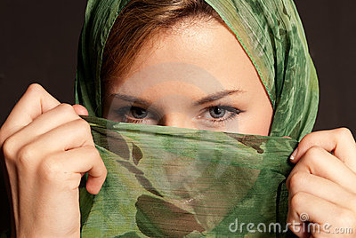 Young arab woman with veil showing her eyes