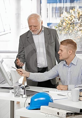 Young architect discussing work with boss
