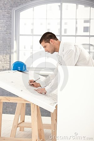 Young architect drawing plans