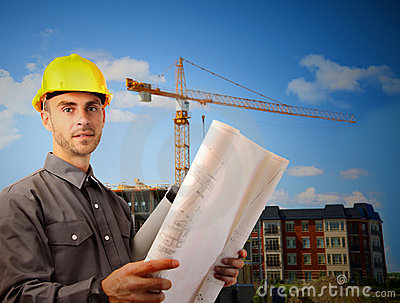 Young architect in front of  building site