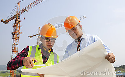 Young architects discussion in front of construction site