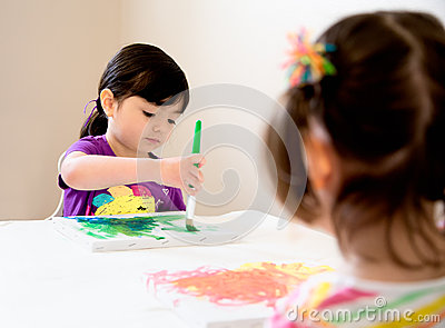 Young artists painting