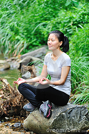 Woman meditation in jungle