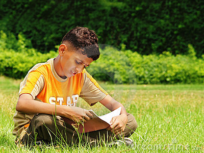 Young asian boy studying