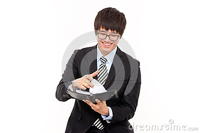 Young Asian business man with diary.