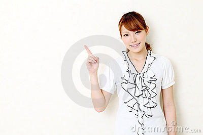 Young asian business woman pointing