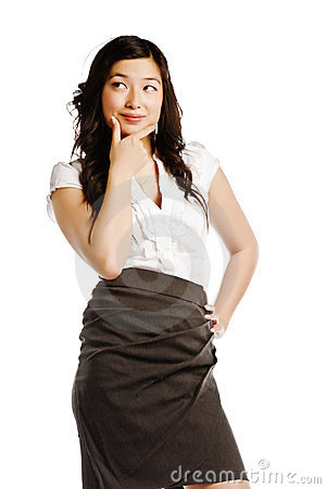 Young asian business woman staring at copyspace