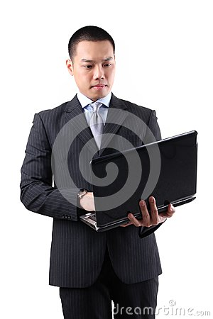Young asian businessman holding laptop