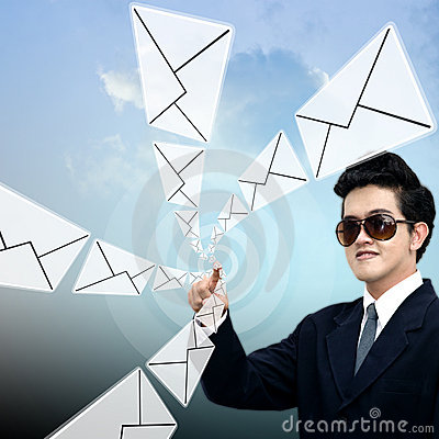 Young Asian businessman sending email