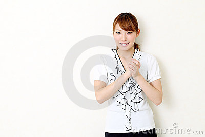 Young asian businesswoman with her hands clasped