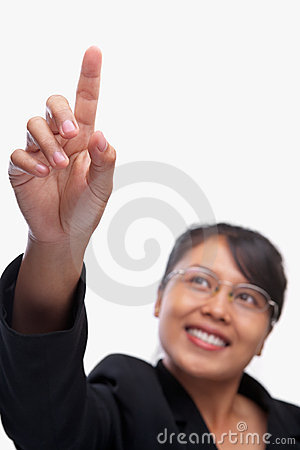 Young Asian businesswoman pointing her finger
