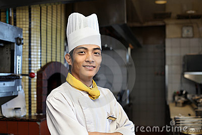 Young asian chef posing
