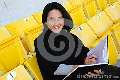 Young Asian college student on grandstand