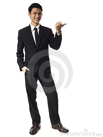 Young Asian Corporate Man pointing with thumb over