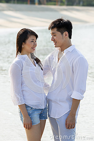 Young Asian couple in love on beach