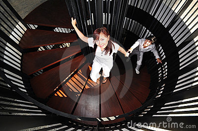Young Asian Couple in Love climbing stairs