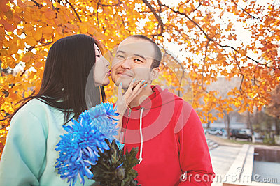 Young asian couple in love and having autumn fun