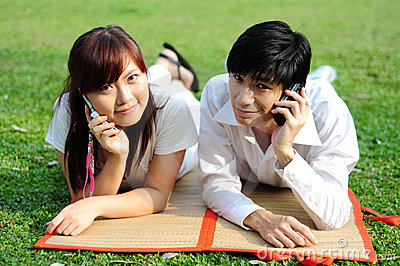 Young Asian Couple in Love using mobile