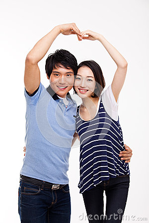 Young Asian couple make heart shape