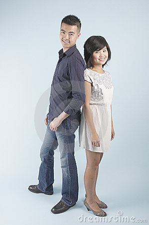 A young Asian couple standing