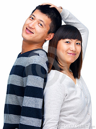 Young asian couple standing back to back