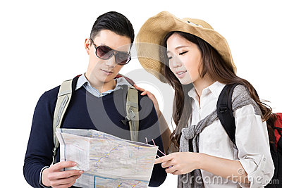 Young Asian couple travelers looking the map