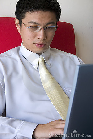 Young Asian Entrepreneur Working
