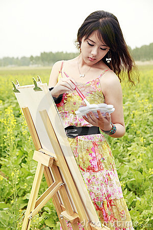 Young Asian female painter