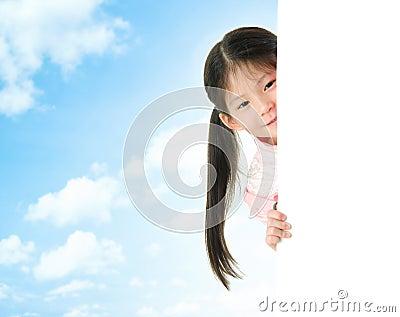 Asian girl hiding behind a blank white card