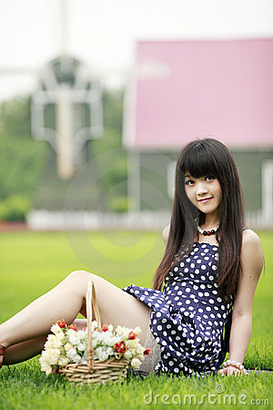 Young Asian girl on the lawn