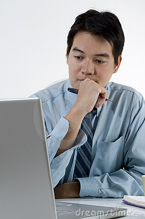 Young Asian male with computer
