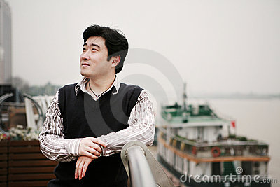 Young asian man beside aboard
