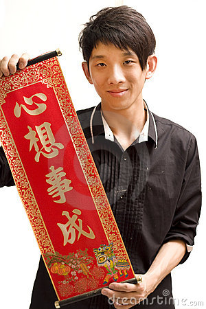 Young Asian man holding chinese lucky word for chi