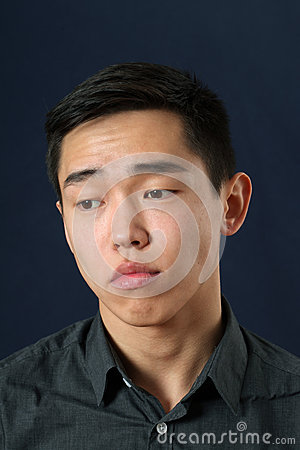 Free Young Asian Man Looking Down Royalty Free Stock Images - 52068789