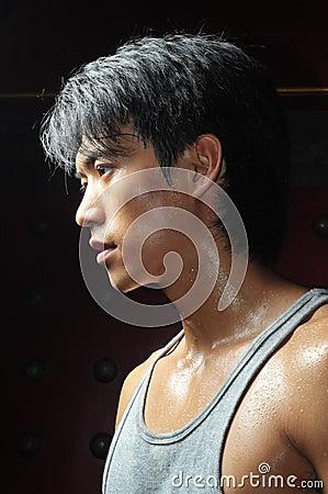 Young Asian Man Perspiring