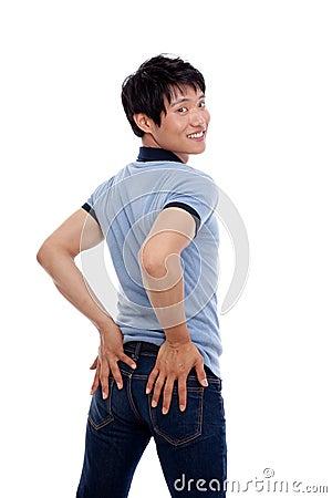 Young Asian man showing bottom
