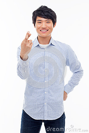 Free Young Asian Man Showing Lucky Sign. Stock Photography - 30100032