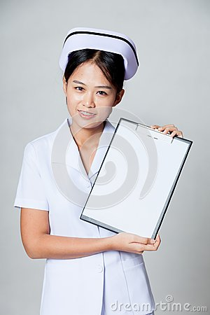 Young Asian nurse show blank paper on clipboard