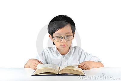 Young Asian schoolboy reading book