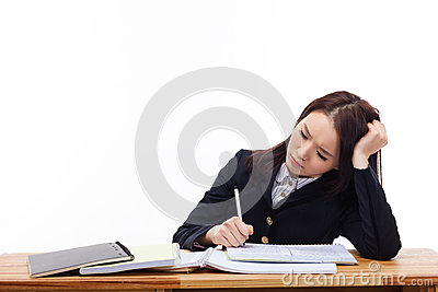 Young Asian student having trouble on desk.