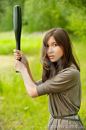 Young asian woman with bat