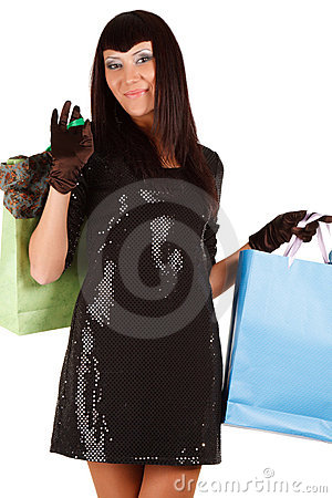 Young asian woman carrying shopping bag