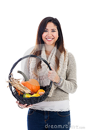 Young Asian woman with fall harvest basket