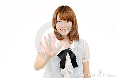Young asian woman giving good bye