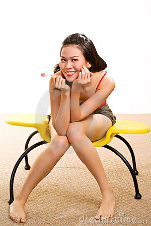 Young asian woman having fun with lollipop
