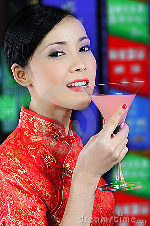 Free Young Asian Woman Holding A Glass Of Cocktail Royalty Free Stock Photo - 10382985