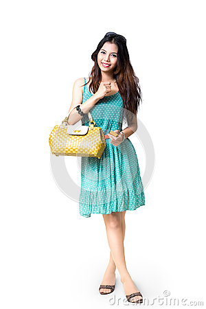 Free Young Asian Woman Holding Handbag Royalty Free Stock Images - 33018709