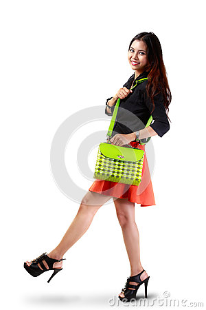 Free Young Asian Woman Holding Handbag Royalty Free Stock Image - 33380246