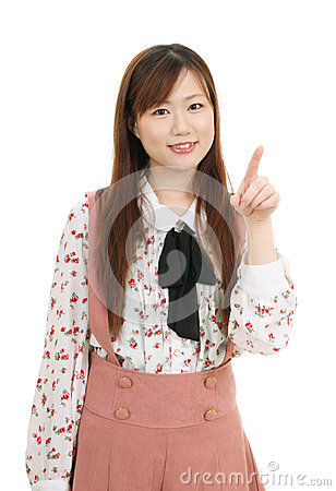 Young asian woman pointing